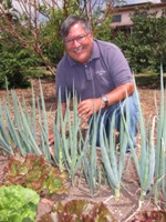 Photo of Tim Constantine in his community garden for nonprofit organizations