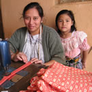 Mother and daughter sewing in Guatemala.