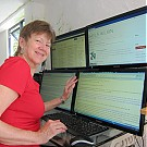 Non profit staff member design a logframe on a computer