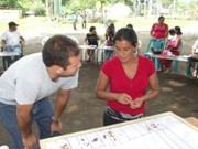 Oscar Recinos with community member during the participatory needs assessment.